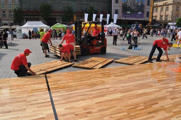 Installation of Action NitroPanel FC portable floor for outdoor charity event, Krakow, Poland