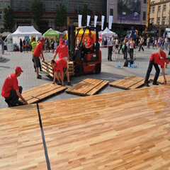 Installation of Action NitroPanel FC portable floor for outdoor charity event, Krakow, Poland